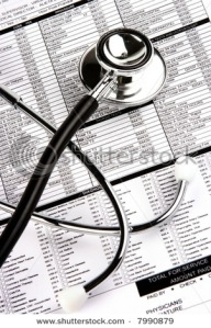 A stethoscope over a medical report form