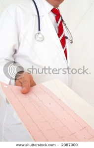 Doctor giving a printout of a heart monitor report
