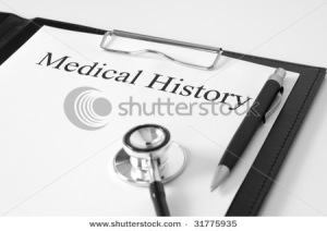 Document showing medical history, stethoscope and a pen