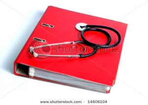 Stethoscope and red file folder,ring binder