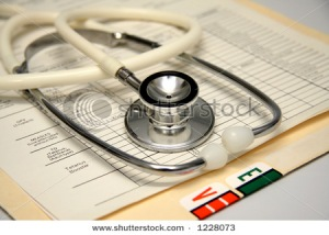 Stethoscope on a patient medical record folder